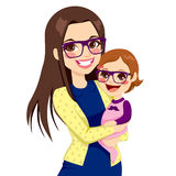 Hipster Mom And Baby. Pretty young hipster style mother with glasses holding and hugging her cute little baby daughter laughing Royalty Free Stock Images