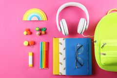 Set of school supplies on paper textured background. Hipster neon green textile backpack, surrounded with school supplies. Back to school concept. Lots of stock image