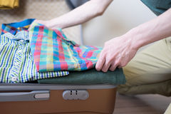 Hipster packing his stuff Stock Photos