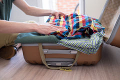 Hipster packing his stuff Royalty Free Stock Images