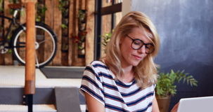 Hipster people using laptop. In cafe stock footage