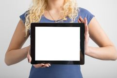 Person holding blank screen tablet in hands royalty free stock photography