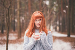 Hipster. Photo redheaded girl with a cup in his hand. Royalty Free Stock Photos