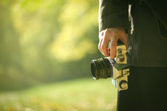 Hipster photographer exploring autumn nature landscapes Stock Photography
