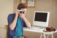 Hipster photographer taking a photo Royalty Free Stock Photos