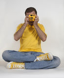 Hipster photographer in yellow clothing Stock Photos