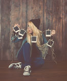 Hipster Photography Girl Looking at Film Photos Royalty Free Stock Image