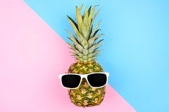 Hipster pineapple with sunglasses over a blue and pink background Royalty Free Stock Photo