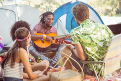 Hipster playing guitar for his friends Stock Photo
