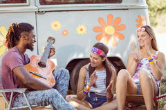 Hipster playing guitar for his friends Stock Image
