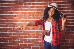 Hipster pointing and holding camera Royalty Free Stock Image