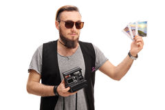 Hipster posing with a polaroid camera. And polaroid photos isolated on white background Stock Photography
