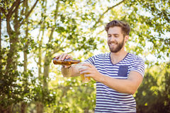 Hipster pouring himself a beer Royalty Free Stock Images