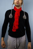 Hipster with red scarf. Young multiracial man with red scarf and alpaca hat Stock Photography