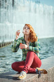 Hipster redhead girl blowing bubbles Royalty Free Stock Photo