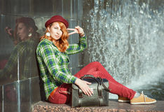 Hipster redhead girl in checkered shirt showing victory gesture Royalty Free Stock Photography