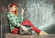 Hipster redhead girl showing victory gesture stock images