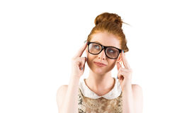 Hipster redhead looking up thinking Royalty Free Stock Image