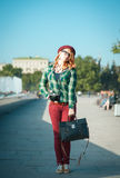Hipster redhead woman in hat and glasses with retro camera Royalty Free Stock Photography