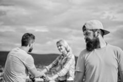 Hipster regretful face in front of couple in love. Man hipster feels lonely couple dating behind him. No romantic in his royalty free stock images