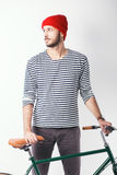 Hipster with retro bicycle. Bearded guy with retro bicycle. Studio shot stock photography