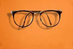 Hipster Retro fashion glasses on orange background Royalty Free Stock Photography