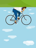 Hipster rides a bicycle in the sky Royalty Free Stock Photo