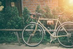 Hipster road bike leather seat old style parking. Vintage color tone Stock Image