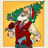 Hipster Santa Claus with Christmas tree Royalty Free Stock Photo