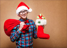 Hipster in Santa Claus Royalty Free Stock Image