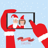 Hipster santa claus and little girl selfie with smartphone for m Stock Photography