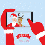Hipster santa claus and reindeer selfie with smartphone for merr Royalty Free Stock Photography