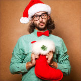 Hipster Santa Claus with the socks of the presents Royalty Free Stock Photos