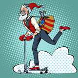 Hipster Santa Claus spreads the Christmas gifts on Royalty Free Stock Photo