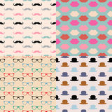 Hipster Seamless Pattern Set. Vector Hipster Seamless Patterns, lips, glasses, mustaches, hats Royalty Free Stock Photos