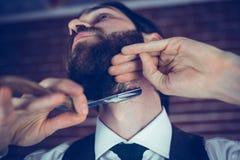 Hipster shaving beard Stock Photo
