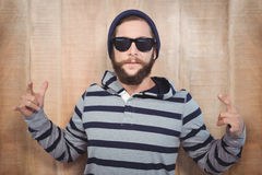 Hipster showing rock and roll hand sign Royalty Free Stock Image