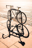 Hipster single gear fixie bicycle locked to a metal stand on a p Royalty Free Stock Photography