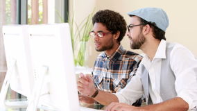 Hipster smiling Men using computer. In office stock footage