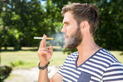 Hipster smoking electronic cigarette Stock Photo