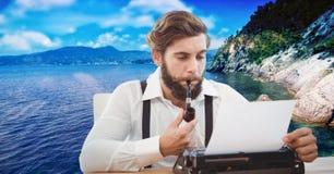 Hipster smoking pipe while using typewriter against lake. Digital composite of Hipster smoking pipe while using typewriter against lake Royalty Free Stock Photos