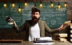 Hipster is solving math exam, Conference training planning learning business coaching concept, Desire to help should be stock photo