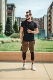 Hipster standing seriously in the street royalty free stock images