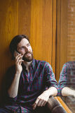 Hipster student on a call in canteen Royalty Free Stock Photos