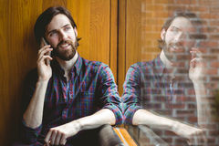 Hipster student on a call in canteen Royalty Free Stock Photo
