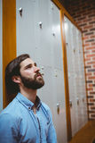 Hipster student feeling sad in hallway Royalty Free Stock Photography