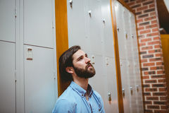 Hipster student feeling sad in hallway Royalty Free Stock Images