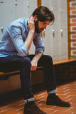 Hipster student feeling sad in hallway Royalty Free Stock Photo