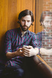 Hipster student having coffee in canteen. At the university Royalty Free Stock Photos