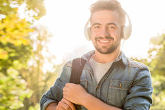 Hipster student man in earphones Stock Images